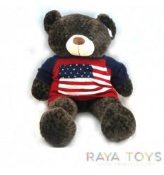 Голяма плюшена мечка със знаме